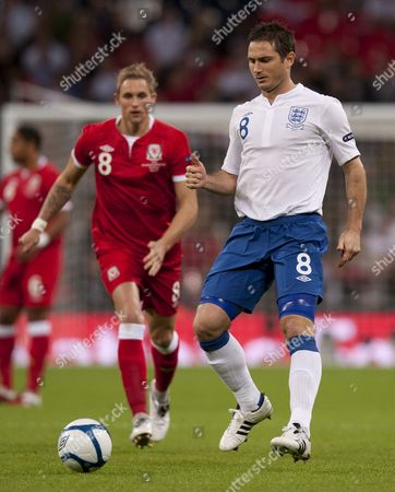 Jack Collison of Wales and Frank Lampard of England United Kingdom London