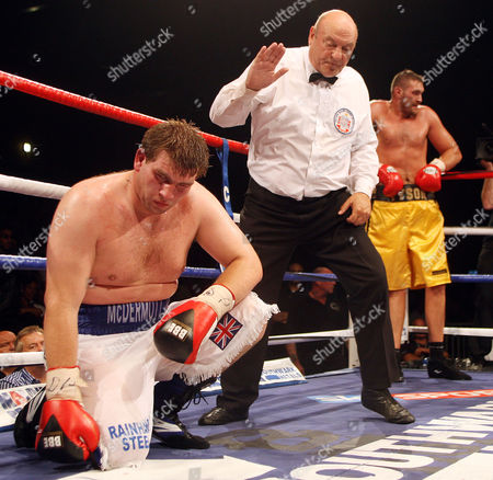 John Mcdermott is Counted out by the Referee As Tyson Fury Waits in the Corner England
