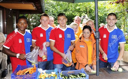 (l-r) Hamburg's Ze Roberto Tom Mickel Robert Tesche and Mladen Petric Prepare Vegetables For the Animals at Hagenbecks Zoo As Part of the Hamburg Social Affairs Commitment Project