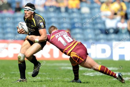 Stock Image of Scott Moore of Celtic Crusaders is Tackled by Keith Mason of Huddersfield Giants United Kingdom Edinburgh
