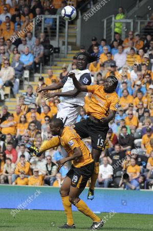 Bernard Mendy and Steven Mouyokolo of Hull City Are Beaten in the Air by Kenwyne Jones of Sunderland United Kingdom Hull