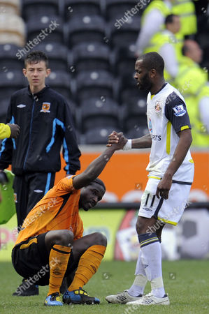 A Dejected Bernard Mendy of Hull City is Helped to His Feet by Darren Bent of Sunderland at the End of the Game United Kingdom Hull