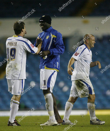 Ben Parker Enoch Showunmi and Andrew Robinson of Leeds United Celebrate After the Game United Kingdom Leeds