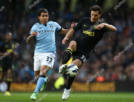 Paul Scharner of Wigan Athletic and Carlos Tevez of Manchester City United Kingdom Manchester