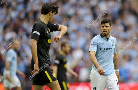 Sergio Aguero of Manchester City Looks On As Paul Scharner of Wigan Athletic Complains About Being Elbowed United Kingdom London