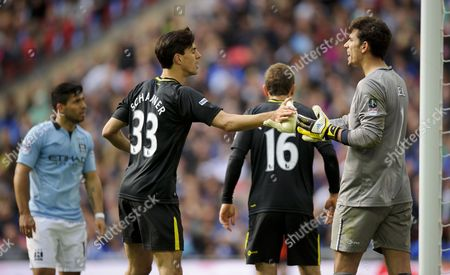 Paul Scharner Shakes Hands with Goalkeeper Joel Robles of Wigan Athletic United Kingdom London