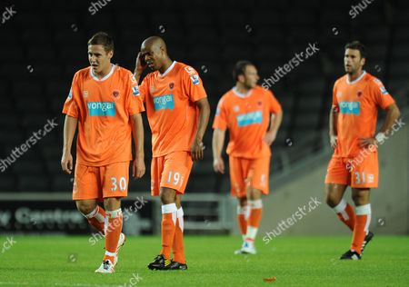 Blackpool Players Stephen Husband Ludovic Sylvestre Dekel Keinan and Neal Eardley Stand Dejected After Conceading to Mk Dons