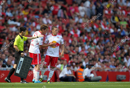 John Rooney of New York Red Bulls Replaces Chris Albright and Takes to the Pitch Amidst A Chorus if Booing From the Arsenal Fans United Kingdom London
