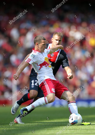 John Rooney of New York Red Bulls in Action with Mathieu Bodmer of Paris Saint-germain United Kingdom London