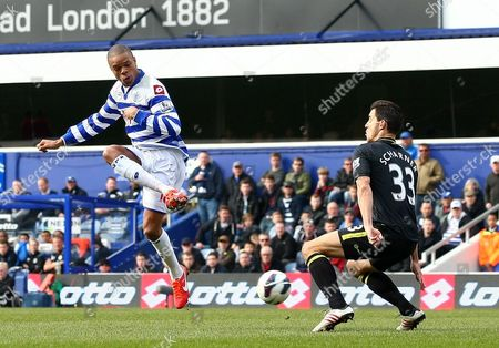 Queens Park Rangers' Loic Remy Shoots at the Goal Past Wigan Athletic's Paul Scharner United Kingdom London