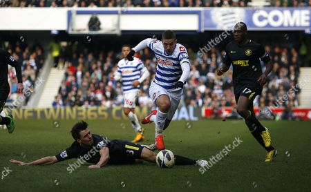 Queens Park Rangers' Adel Taarabt Charges Forward Under Pressure From Wigan Athletic's Paul Scharner United Kingdom London