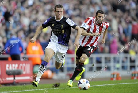 Stock Photo of Jordan Henderson of Liverpool and Carlos Cuellar of Sunderland Gb Sunderland