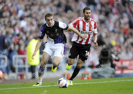 Stock Picture of Jordan Henderson of Liverpool and Carlos Cuellar of Sunderland Gb Sunderland