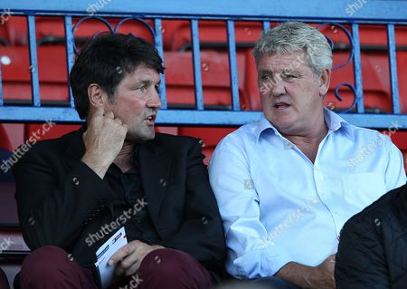 Milton Keynes Dons Assistant Manager Mick Harford and Hull City Manager Steve Bruce Talk in the Stands United Kingdom Swindon