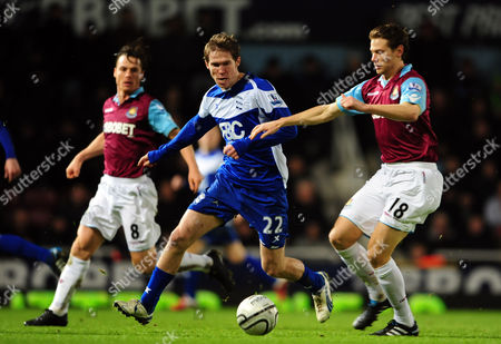 Jonathan Spector and Scott Parker of West Ham United Takes On Alexander Hleb of Birmingham City United Kingdom London