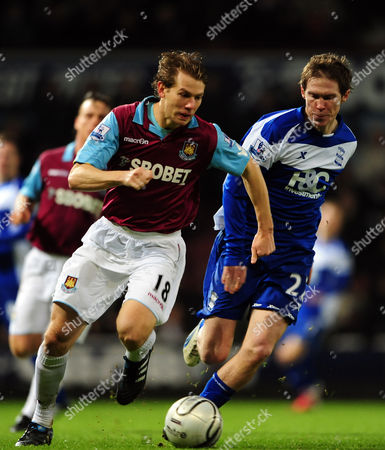 Jonathan Spector of West Ham United Takes On Alexander Hleb of Birmingham City United Kingdom London