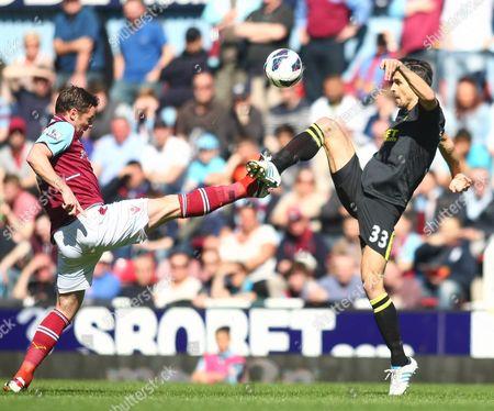 West Ham United's Kevin Nolan Battles with Wigan Athletic's Paul Scharner United Kingdom London