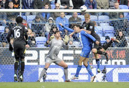 Paul Scharner of Wigan Athletic Blocks the Shot of Michael Turner of Norwich City United Kingdom Wigan