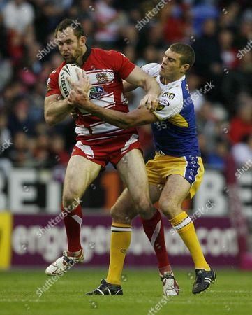Pat Richards of Wigan Warriors is Tackled by Matt King of Warrington Wolves United Kingdom Wigan
