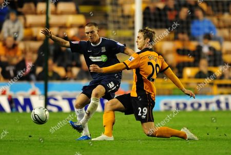 Stock Photo of Kevin Doyle of Wolverhampton Wanderers and Peter Gilbert of Southend United United Kingdom Wolverhampton