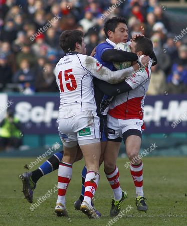 Bath Centre Shontayne Hape is Tackled by Ulster Fly Half Ian Humphreys and Team Mate Adam D'arcy United Kingdom Bath