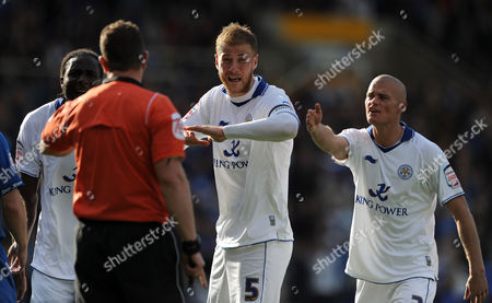 Matt Mills (centre) and Paul Konchesky (right) of Leicester City Argue with Forth Official Kevin Wright After He Awarded A Penalty United Kingdom Birmingham