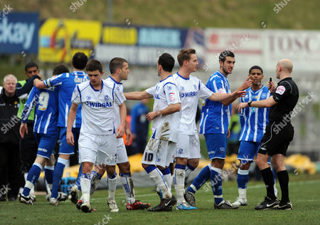 The Referee Steve Rushton Breaks Up the Brighton & Hove Albion and Tranmere Rovers Players After A Flare Up United Kingdom Brighton