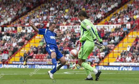 Ipswich Town Striker Michael Chopra Tackles Bristol City Goalkeeper David James Before Scoring A Goal to Make It 0-3 United Kingdom Bristol