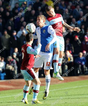 Morten Gamst Pedersen of Blackburn Rovers in Between Ross Wallace and Kieran Trippier of Burnley United Kingdom Burnley