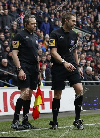 Referee C Pawson Consults His Assistant Before Deciding to Award A Free Kick After Danny Murphy of Blackburn Rovers Kicked Ben Turner of Cardiff City in the Face United Kingdom Cardiff