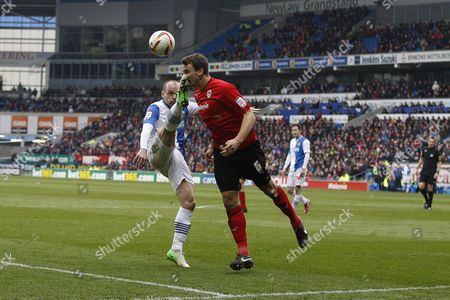 Danny Murphy of Blackburn Rovers Kicks Ben Turner of Cardiff City in the Face Inside the Penalty Area But Referee Mr C Pawson Awards A Free Kick United Kingdom Cardiff