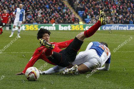 Kim Bo-kyung of Cardiff City is Tackled by David Bentley of Blackburn Rovers United Kingdom Cardiff