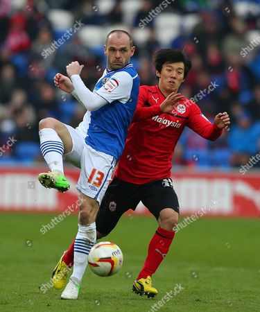Danny Murphy of Blackburn Rovers and Kim Bo-kyung of Cardiff City United Kingdom Cardiff