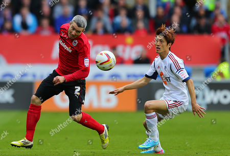 Kevin Mcnaughton of Cardiff City and Chung-yong Lee of Bolton Wanderers in Action United Kingdom Cardiff