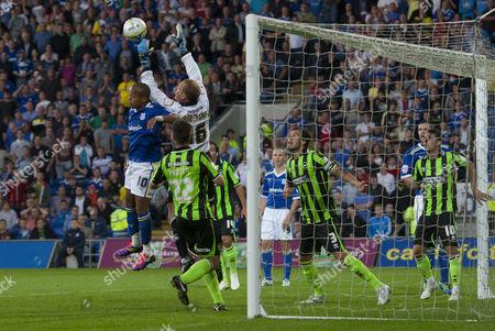 Casper Ankergren of Brighton & Hove Albion Claims the Ball Whilst Under Pressure From Cardiff City Striker Robert Earnshaw United Kingdom Cardiff