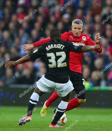 Kevin Mcnaughton of Cardiff City and Callum Harriott of Charlton Athletic in Action United Kingdom Cardiff