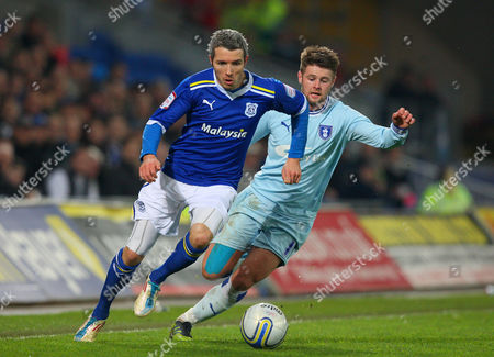 Cardiff City Defender Kevin Mcnaughton and Oliver Norwood of Coventry City in Action United Kingdom Cardiff