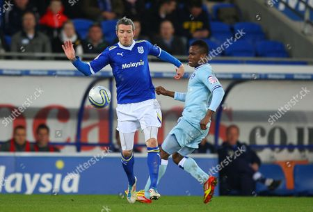 Cardiff City Defender Kevin Mcnaughton and Alex Nimely of Coventry City in Action United Kingdom Cardiff