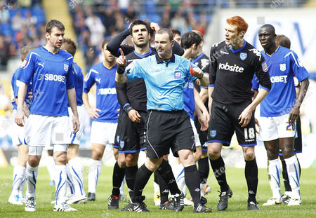 Portsmouth Defender Ricardo Rocha (c) is Shown A Red Card by Referee Kevin Wright United Kingdom Cardiff
