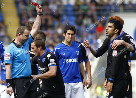Portsmouth Defender Ricardo Rocha (r) is Shown A Red Card by Referee Kevin Wright United Kingdom Cardiff