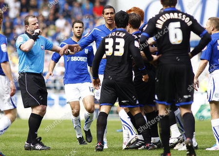 Cardiff City Striker Jay Bothroyd and Portsmouth Defender Ricardo Rocha Clash Infront of Referee Kevin Wright Before Rocha Receives A Red Card United Kingdom Cardiff