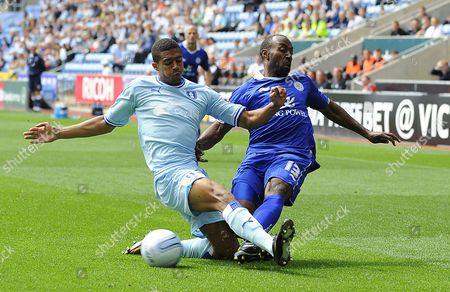 Leicester City's Darius Vassell is Challenged by Coventry City's Cyrus Christie United Kingdom Coventry