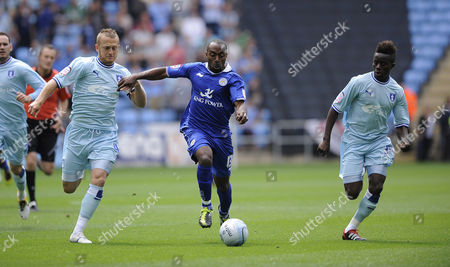 Leicester City's Darius Vassell is Challenged by Coventry Pair Sammy Clingan Right and Gael Bigirimana United Kingdom Coventry