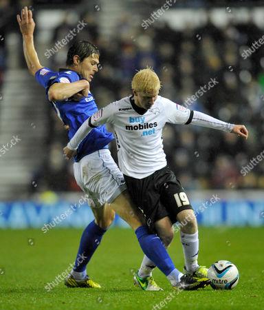 Nikola Zigic of Birmingham City and Will Hughes of Derby County United Kingdom Derby