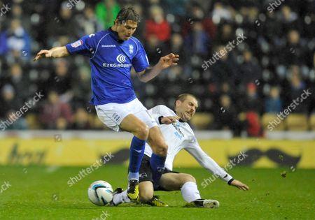Nikola Zigic of Birmingham City and Jake Buxton of Derby County United Kingdom Derby