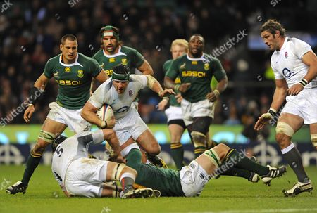 Hendre Fourie of England is Tackled by Bakkies Botha of South Africa United Kingdom London