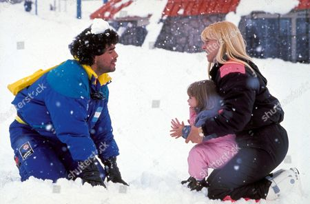 Diego Maradona Plays in the Snow with His Wife Claudia Villafane and Daughter Giannina File Photo Dated 14/12/1989