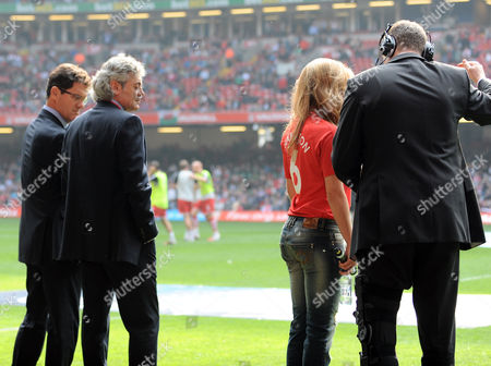 Stock Picture of Manager of England Fabio Capello and Assistant Franco Baldini Check out Miss Wales Courtenay Hamilton Who Sang the National Anthems Euro 2012 Qualifying - Group G England V Wales 26 March 2011 United Kingdom
