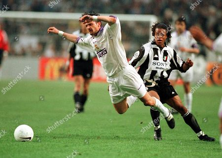 Real Madrid's Predrag Mijatovic (l) Goes Down Under A Challenge From Juventus' Edgar Davids (r) File Photo Dated 20/5/1998