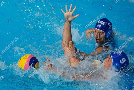 Australia's Holly Lincoln-smith is Held by the Greece Defenders Kyriaki Liosi and Angeliki Gerolimou (9) During Ausralia's 4-3 Loss in the Women's Water Polo Quarter Final Italy